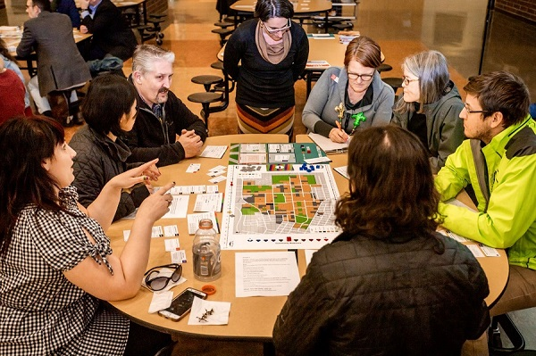 Corvallis residents discuss transportation issues during the Campus Transportation and Parking Board Game.